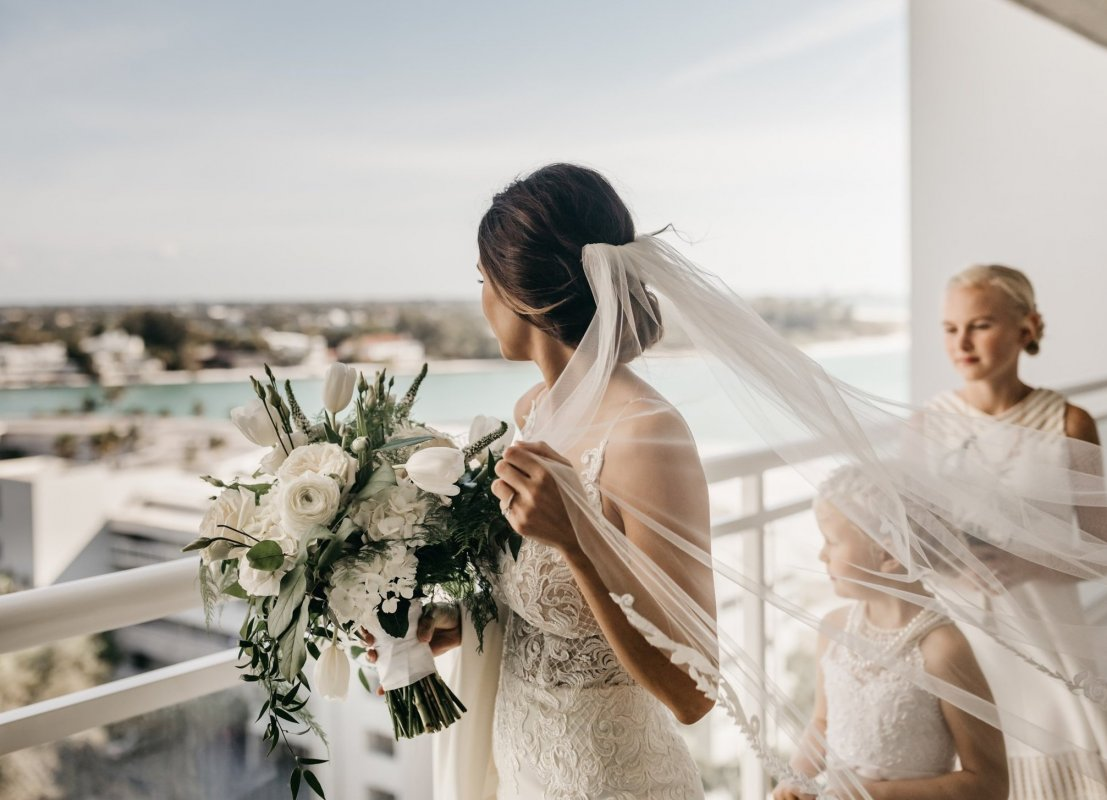 Bride with All-White Bouquet on Balcony