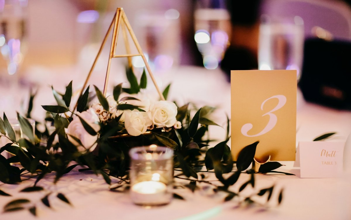Guest Table Centerpiece with Gold Geometric Holder with Roses and Greenery