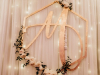 Golden Monogram Wall Hanging Behind Sweetheart Table