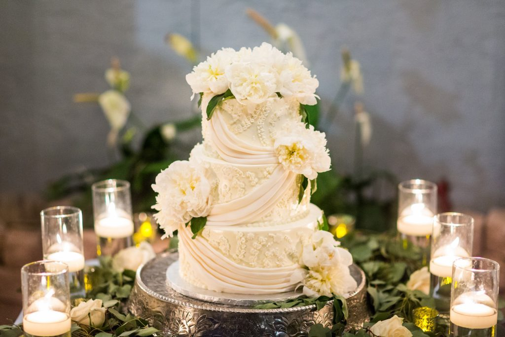 Wedding  Cake with Fresh  Peonies Flowers and Candles