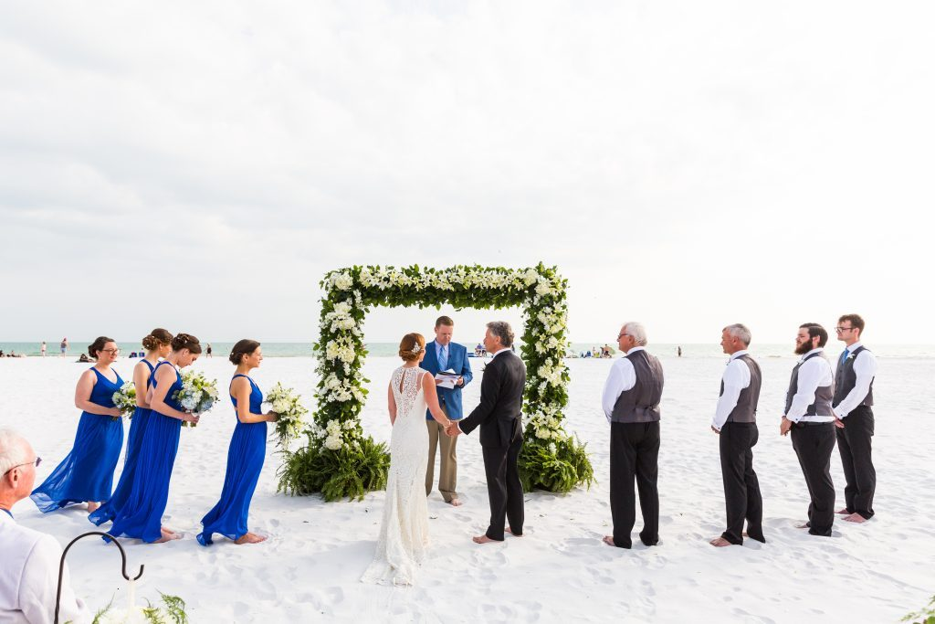 Ceremony Site on the Beach with Lush Greens and Florals