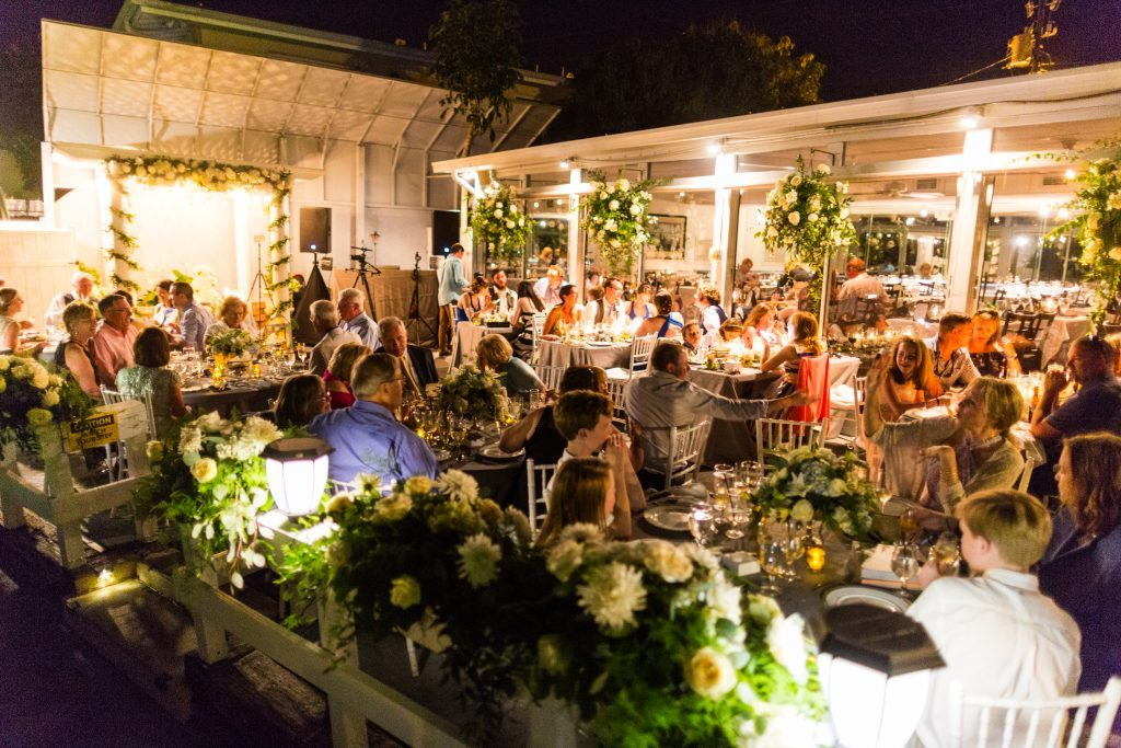 Evening Reception on Deck at Ophelia's by the Bay Restaurant  with Hanging Florals