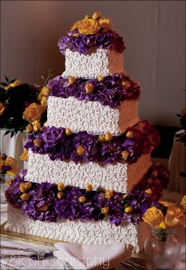 Wedding cake with purple hydrangea yellow roses