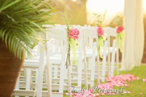 pink rose petals and aisle flowers