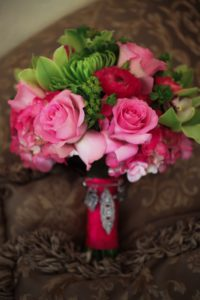 Hot pink and green bridal bouquet with orchids and roses