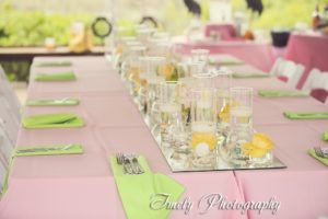 Feasting table with mirrored runner and pink/yellow flowers